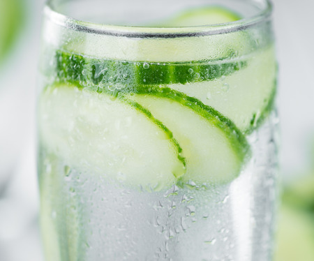 Homemade Cucumber Water on vintage background selective focus; close-up shot