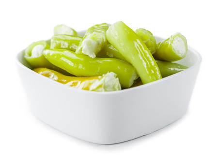 Fresh made Green Chilis (filled with cheese) isolated on white background (close-up shot) Stock fotó