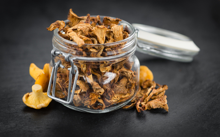 Fresh made Dried Chanterelles on a vintage background as detailed close-up shot