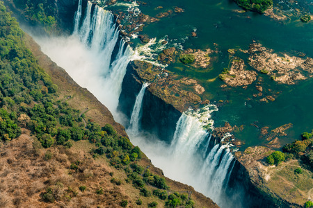 Victoria Falls at drought near Livingstone, Zimbabwe, as aerial shot made from a helicopter