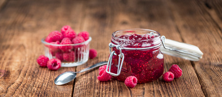 Fresh made Raspberry Jam on a vintage background as detailed close-up shot