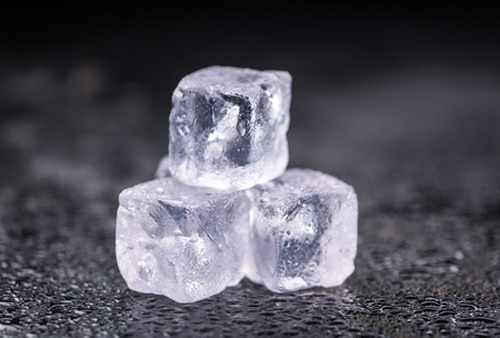 Some melting Ice cubes on a vintage slate slab (selective focus) Stock Photo