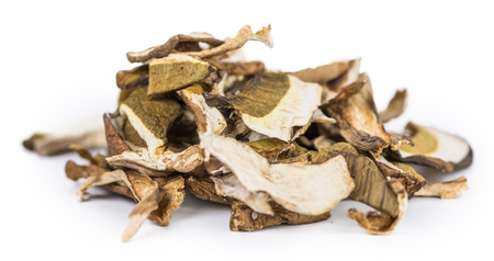 Portion of Dried Porcinis as detailed close-up shot isolated on white background Stock Photo
