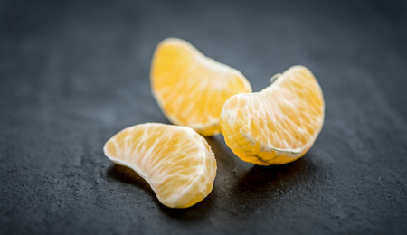 clementines: Fresh Tangerine pieces (selective focus) on a vintage background