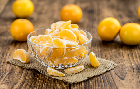 clementines: Raw Tangerine pieces (close-up shot) on vintage background Stock Photo