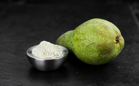 Portion of fresh made Pear powder on a slate slab (selective focus)