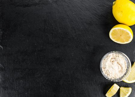 Portion of healthy Lemon powder (selective focus; close-up shot)