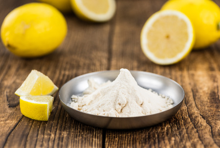 Wooden table with Lemon powder (detailed close-up shot; selective focus) Stock Photo