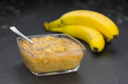 Mashed Bananas (on a vintage slate slab) as detailed close-up shot