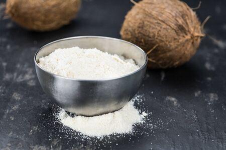 Some fresh made  Coconut flour on a vintage slate slab (selective focus)