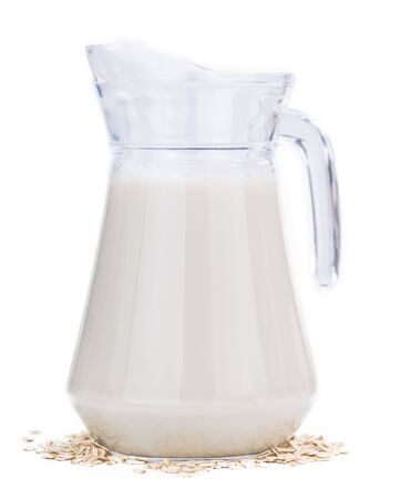 Oat Milk isolated on white background (selective focus; close-up shot)