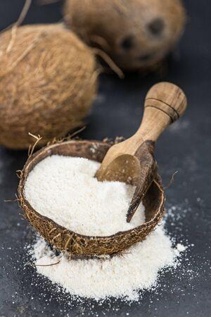 Healthy Coconut flour on a vintage slate slab (close-up shot; selective focus) 免版税图像