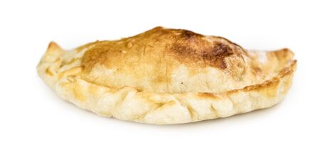 Empanadas as detailed close-up shot isolated on white background (selective focus)