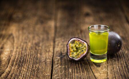 Passion Fruit Liqueur as detailed close-up shot, selective focus