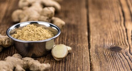 Some healthy Ginger Powder (selective focus; close-up shot) Imagens