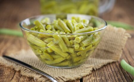 Preserved Green Beans as detailed close-up shot (selective focus) on vintage background