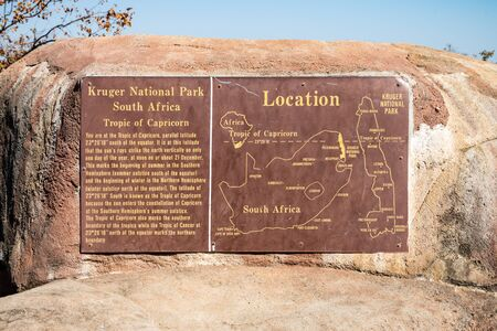 Tropic of Capricorn information sign next to a road in Kruger National Park, South Africa Stock fotó