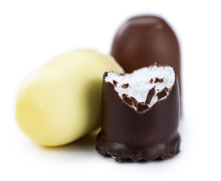 Chocolate Marshmallows isolated on white background (close-up; selective focus)