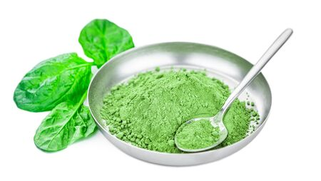 Spinach powder isolated on white background (close up; selective focus)