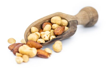 Fresh roasted nuts isolated on white background as close up shot (selective focus) Stock Photo