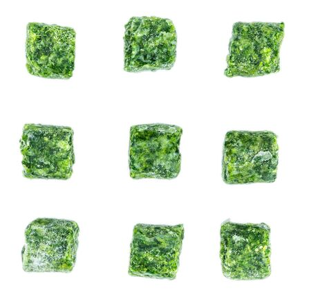 Portion of frozen spinach isolated on white background (close-up shot)