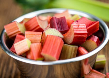 Chopped Rhubarb on an old wooden table (close up shot; selective focus) 版權商用圖片