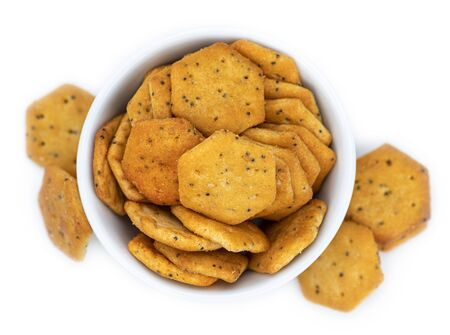 Portion of mixed Snacks isolated on white background (detailed close up shot; selective focus) 版權商用圖片