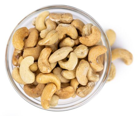 Cashew Nuts isolated on white background (close up shot; selective focus) 版權商用圖片