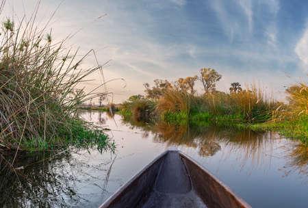 Adventure boat trip in a traditional Makoro at the Okavango Delta, Botswana Reklamní fotografie