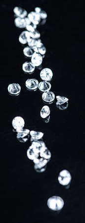 Small Diamonds on dark background as close up shot (selective focus)