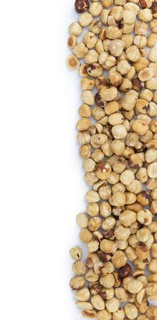 Peeled Hazelnuts as detailed close up shot isolated on white background (selective focus)