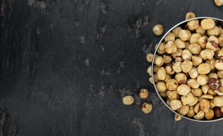 Peeled Hazelnuts as detailed close up shot (selective focus)