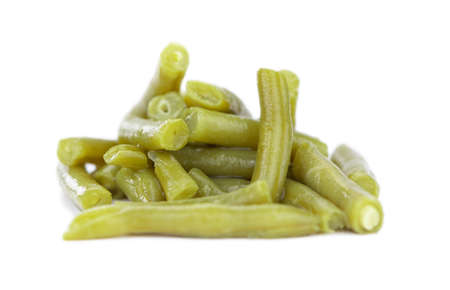 Portion of preserved Green Beans as detailed close-up shot isolated on white background (selective focus)