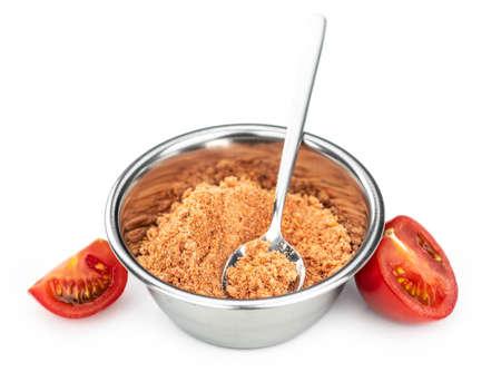 Portion of Tomato Powder isolated on white background (selective focus) Reklamní fotografie