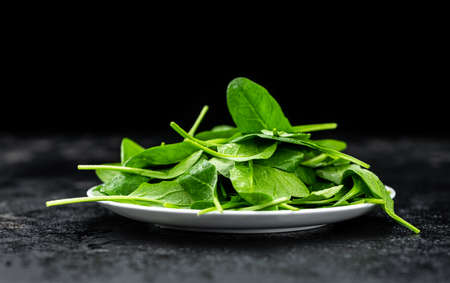 Vintage looking table with fresh Spinach (detailed close-up shot; selective focus) Reklamní fotografie