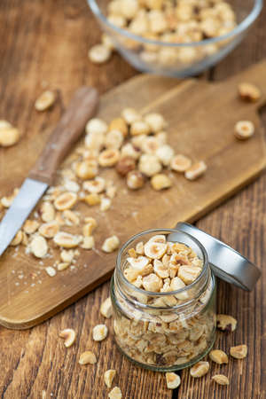 Freshly chopped Hazelnuts as detailed close up shot (selective focus)