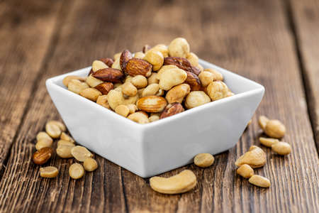 Portion of roasted nuts as detailed close up shot (selective focus)