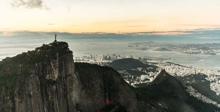 Cristo Redentor statue in Rio de Janeiro (aerial shot made from a helicopter) during a spectacular sunset Reklamní fotografie