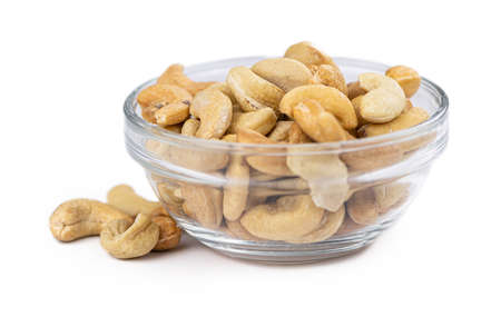 Cashew Nuts isolated on white background (close up shot; selective focus) Reklamní fotografie