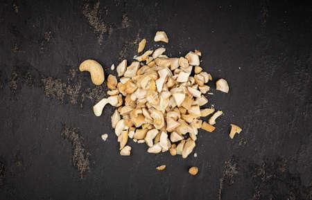 Portion of chopped Cashew nuts (close-up shots, selective focus) Reklamní fotografie