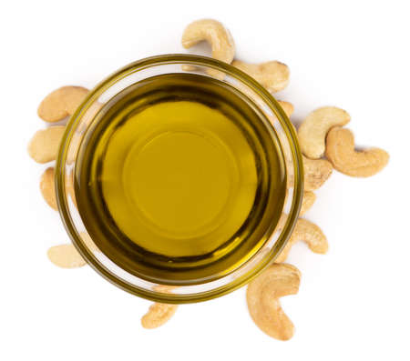 Portion of Cashew Oil isolated on white background (selective focus)