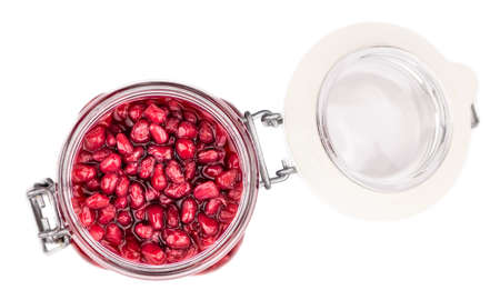 Some preserved Pomegranate seeds isolated on white (selective focus)