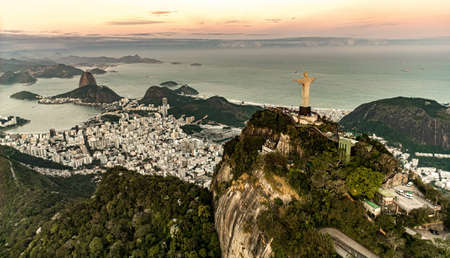 Cristo Redentor statue in Rio de Janeiro (aerial shot made from a helicopter) during a spectacular sunset Redakční