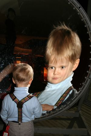spherical: Small boy in front of spherical mirror