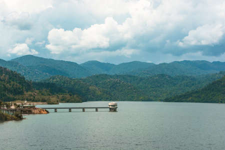 A small engine room in the middle of a state dam//reservoir in Selangor, Malaysia, far away from any cities or towns, isolated from the big buildings, surrounded by nature.