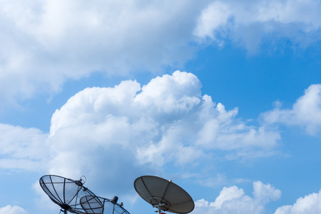 Background Cumulus Clouds and Three Satellite Dish