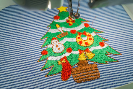 sewing machines: Close up of embroidery machine after embroidered lovely christmas tree full decorations