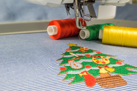 sewing machines: Close up picture Christmas tree full decoration design  make with embroidery machine on fabric Stock Photo