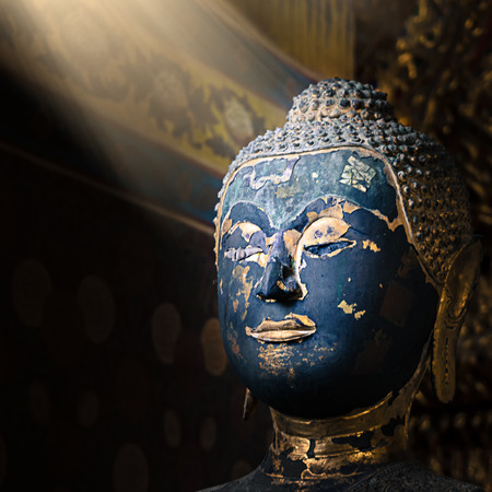 Old statue of buddha close up at head can see damage on face  concept for Faint and Insecurity