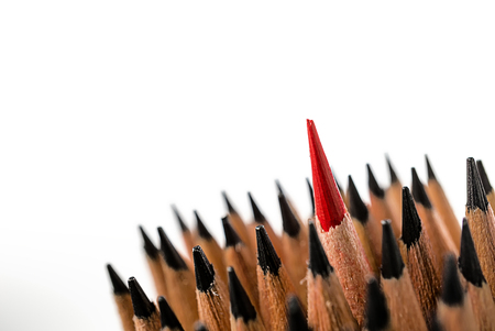 Group of pencils close up to red color pencil stand out of the other on white background, meaning to leader, smart business, success idea, business man